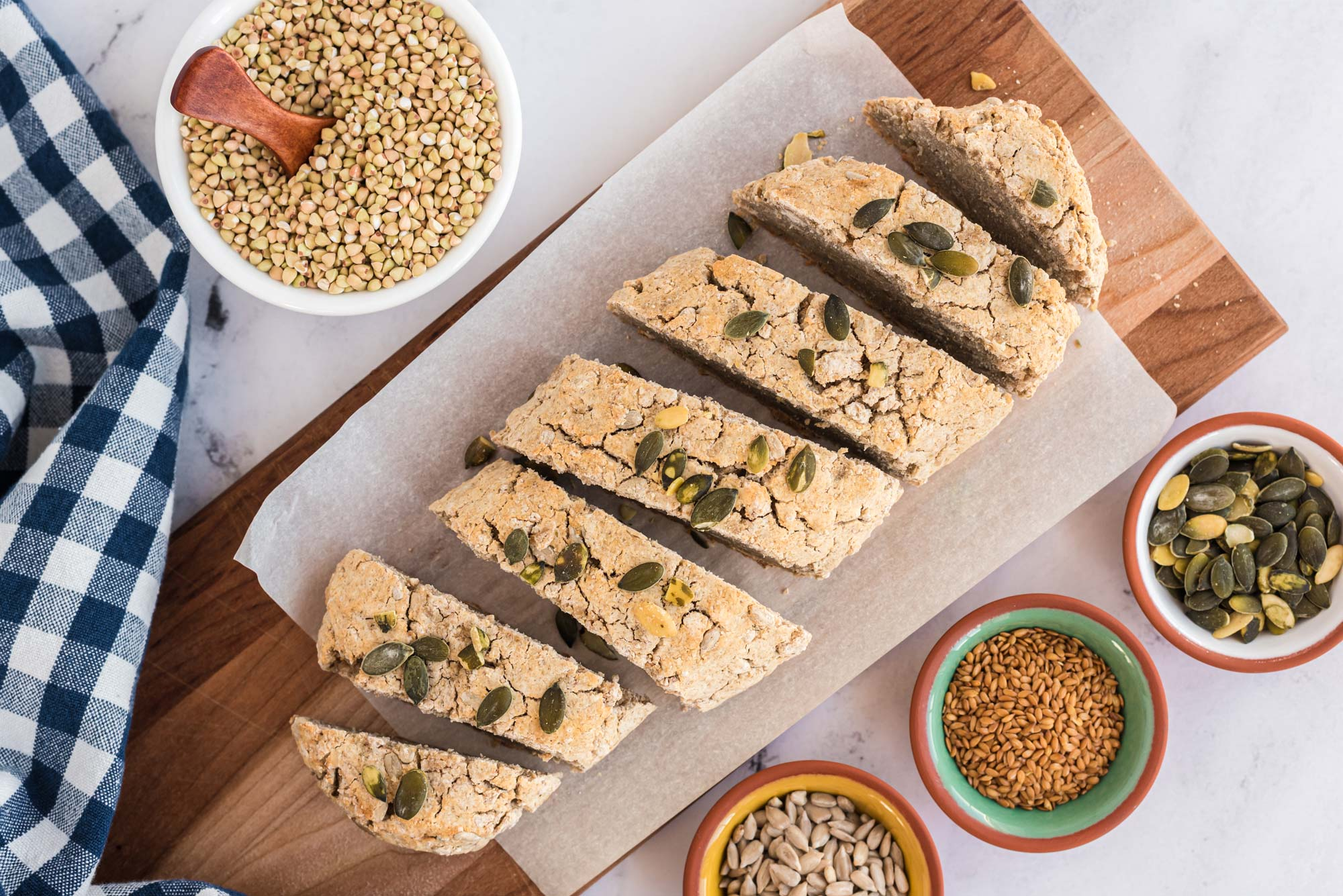 3 seed fermented buckwheat gluten-free bread sliced on cutting board