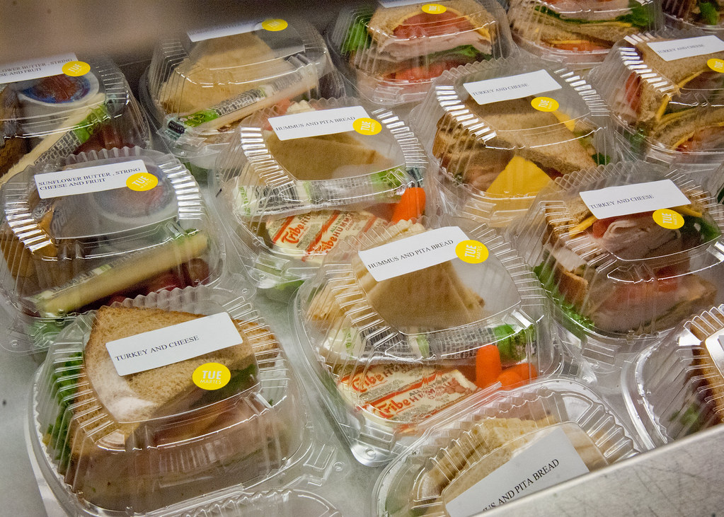 A variety of premade sandwiches at a school