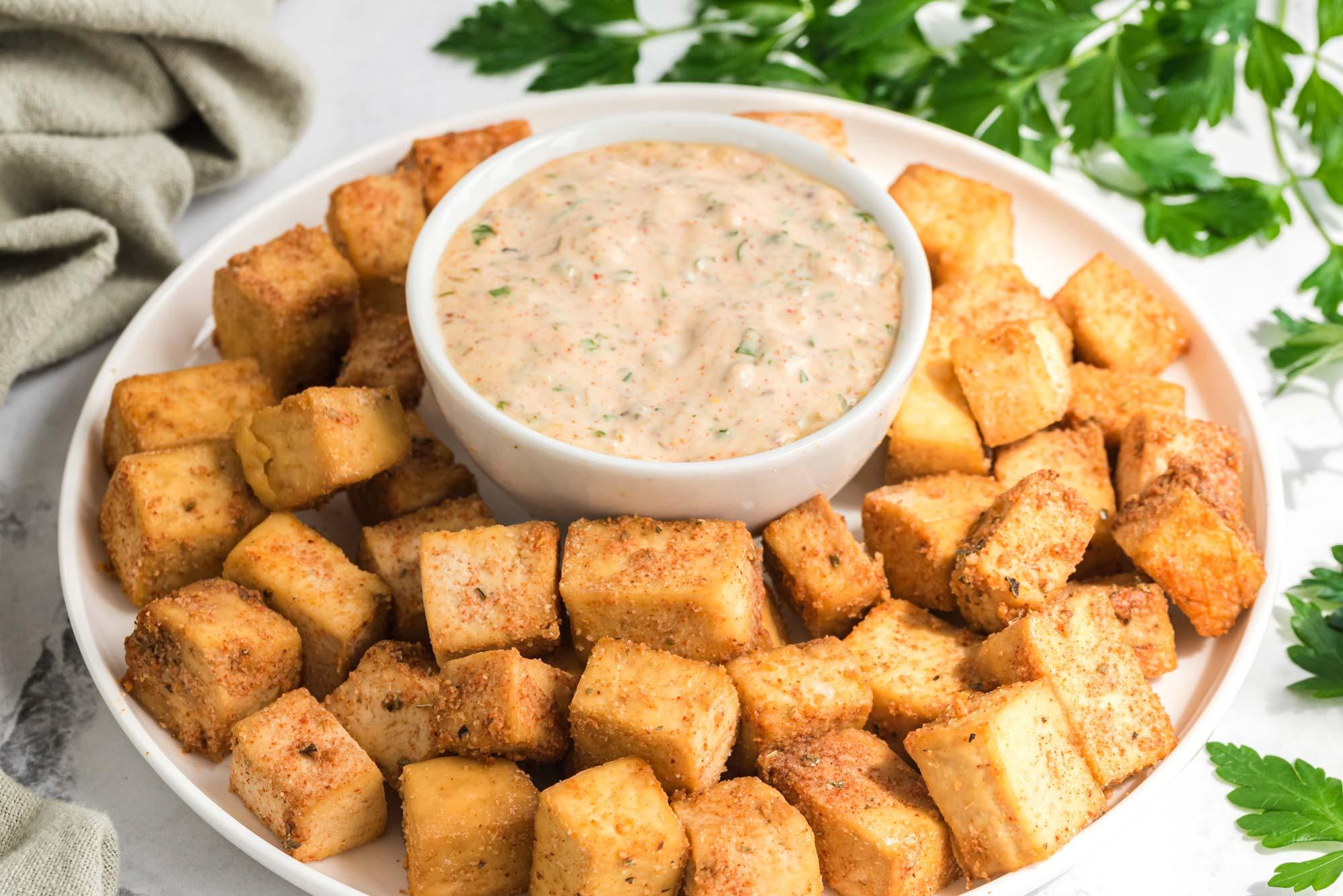 crispy cajun tofu bites in serving dish