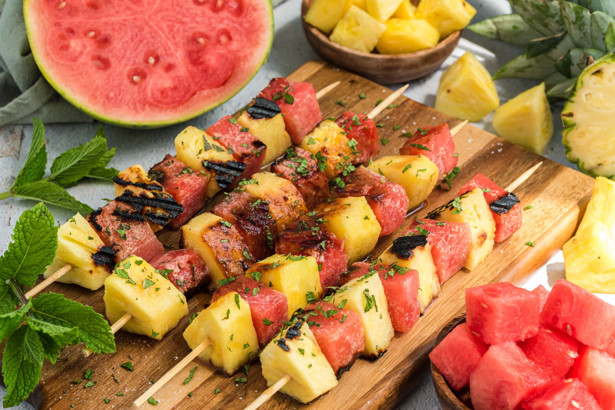grilled watermelon and pineapple skewers on board