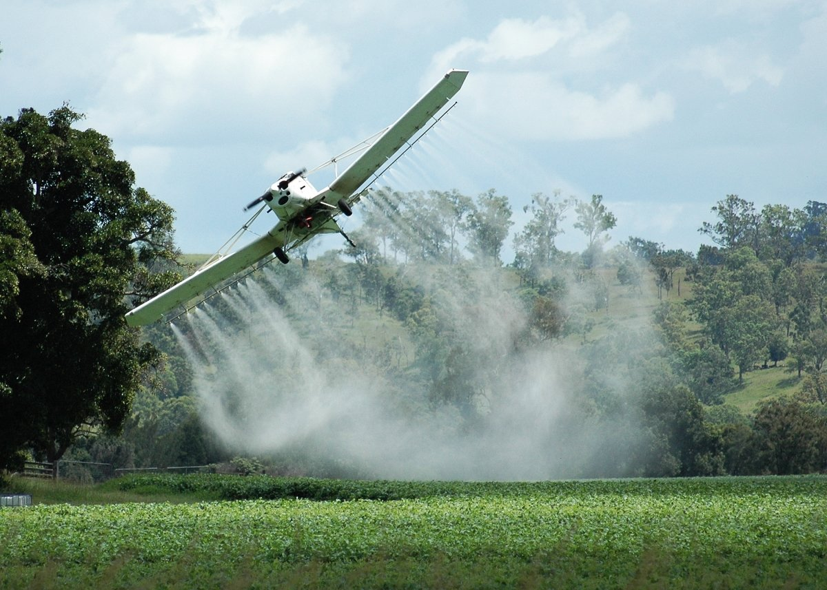 A crop duster dusting crops