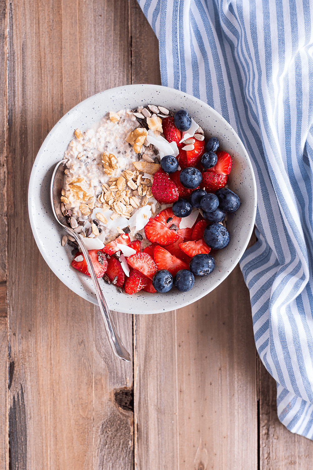 bowl of oats, strawberries, and blueberries