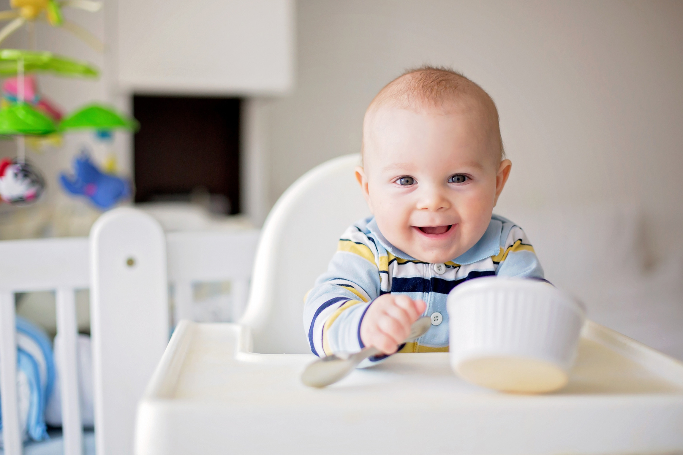 Baby with bowl eating baby food