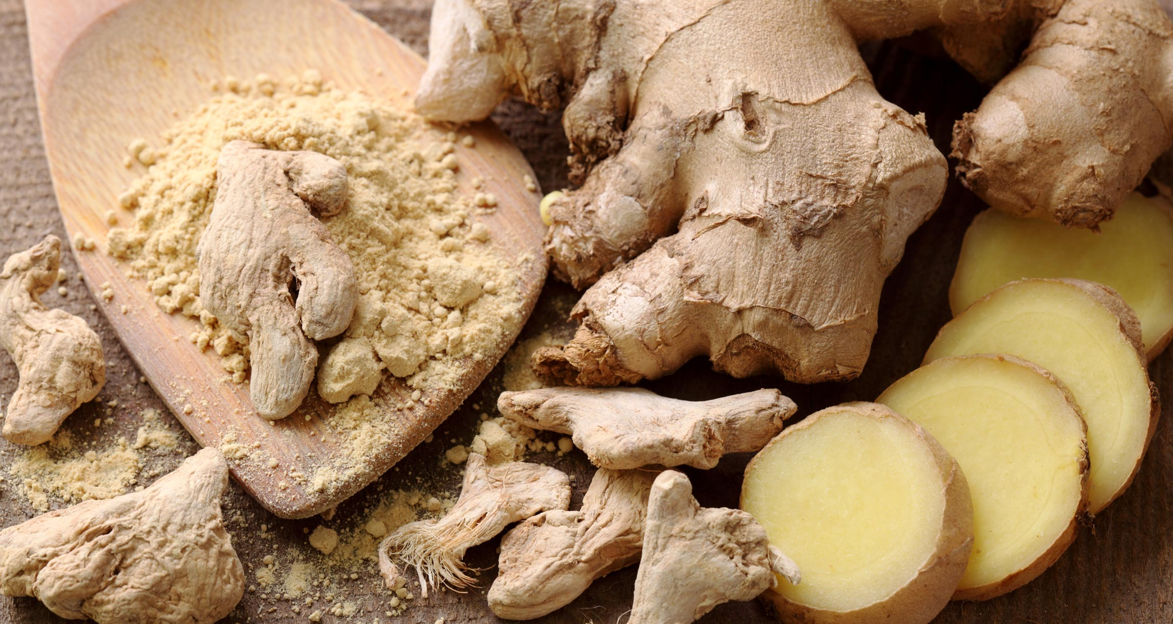 ground, cut, and whole ginger root on table