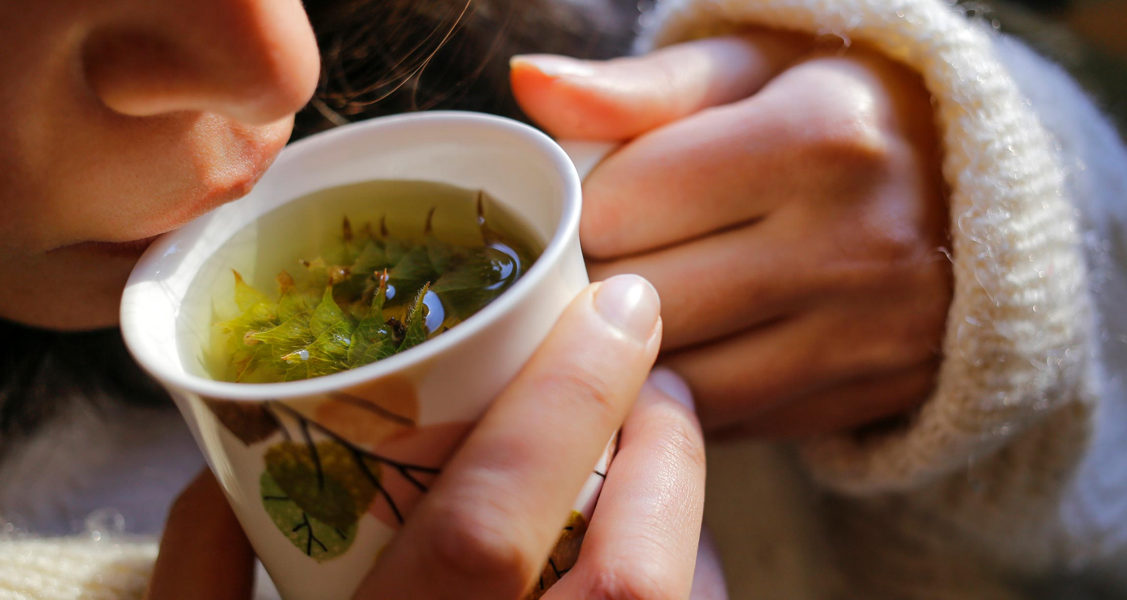 woman drinking sage tea