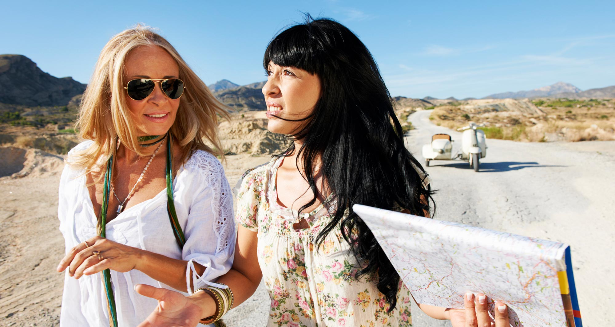 two women holding roadmap