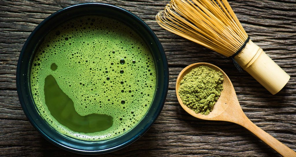 matcha tea with whisk