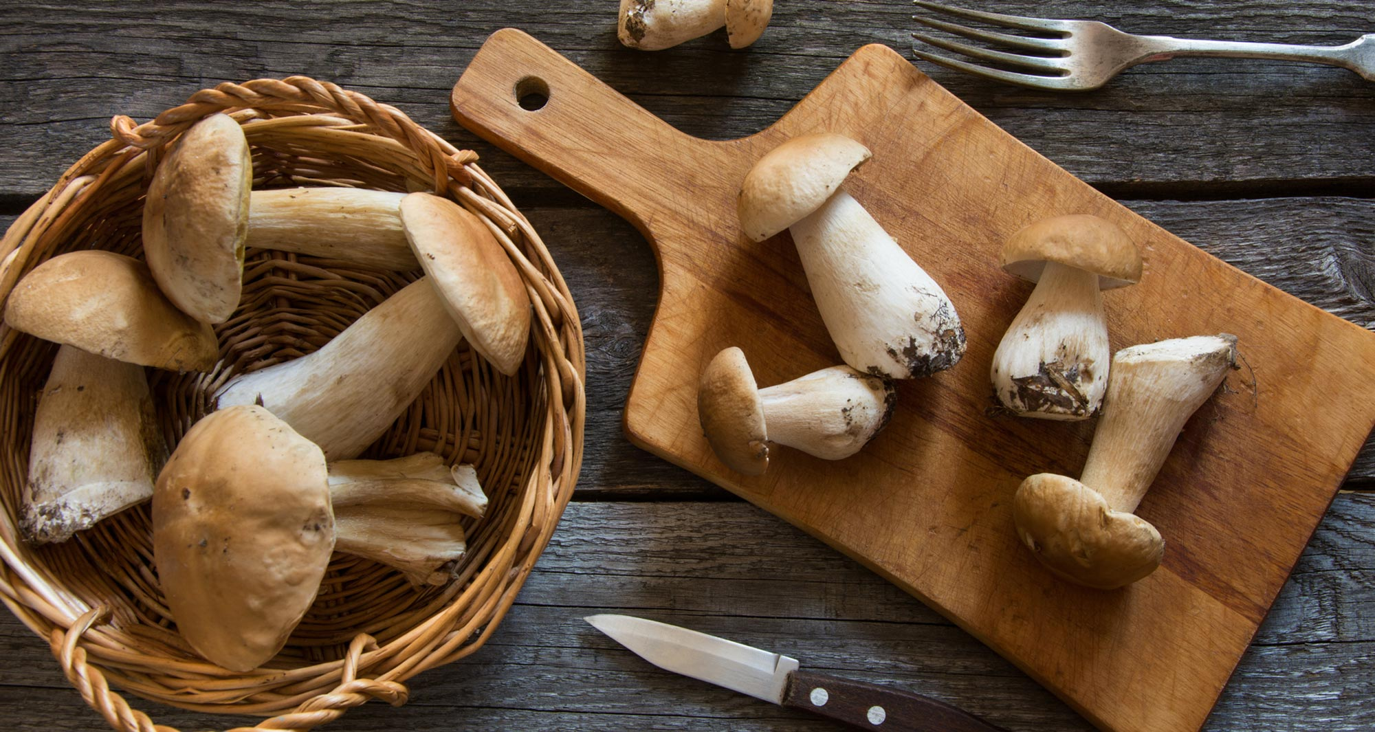 mushrooms in a bowl and on cutting board