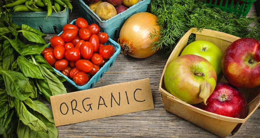 organic fruits and vegetables with sign