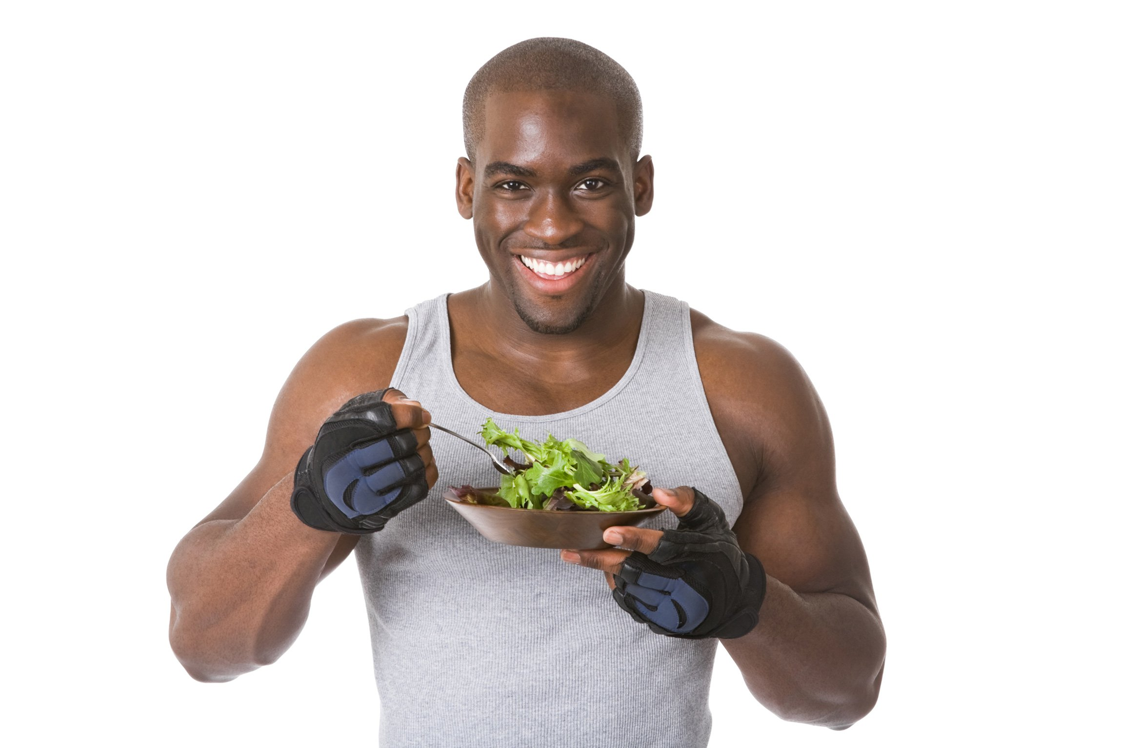 Body builder eating a salad