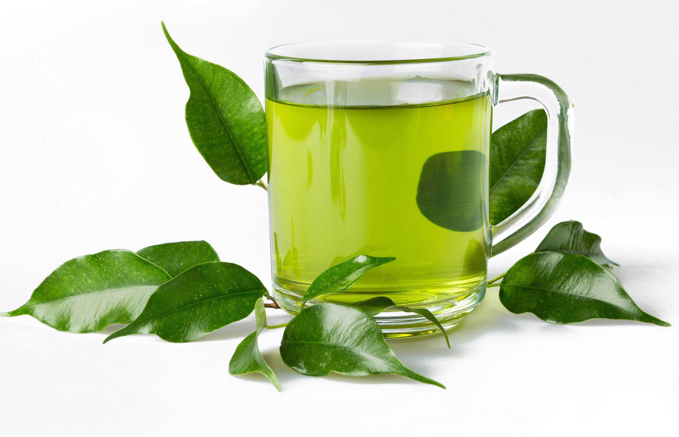 clear glass of green tea with leaves