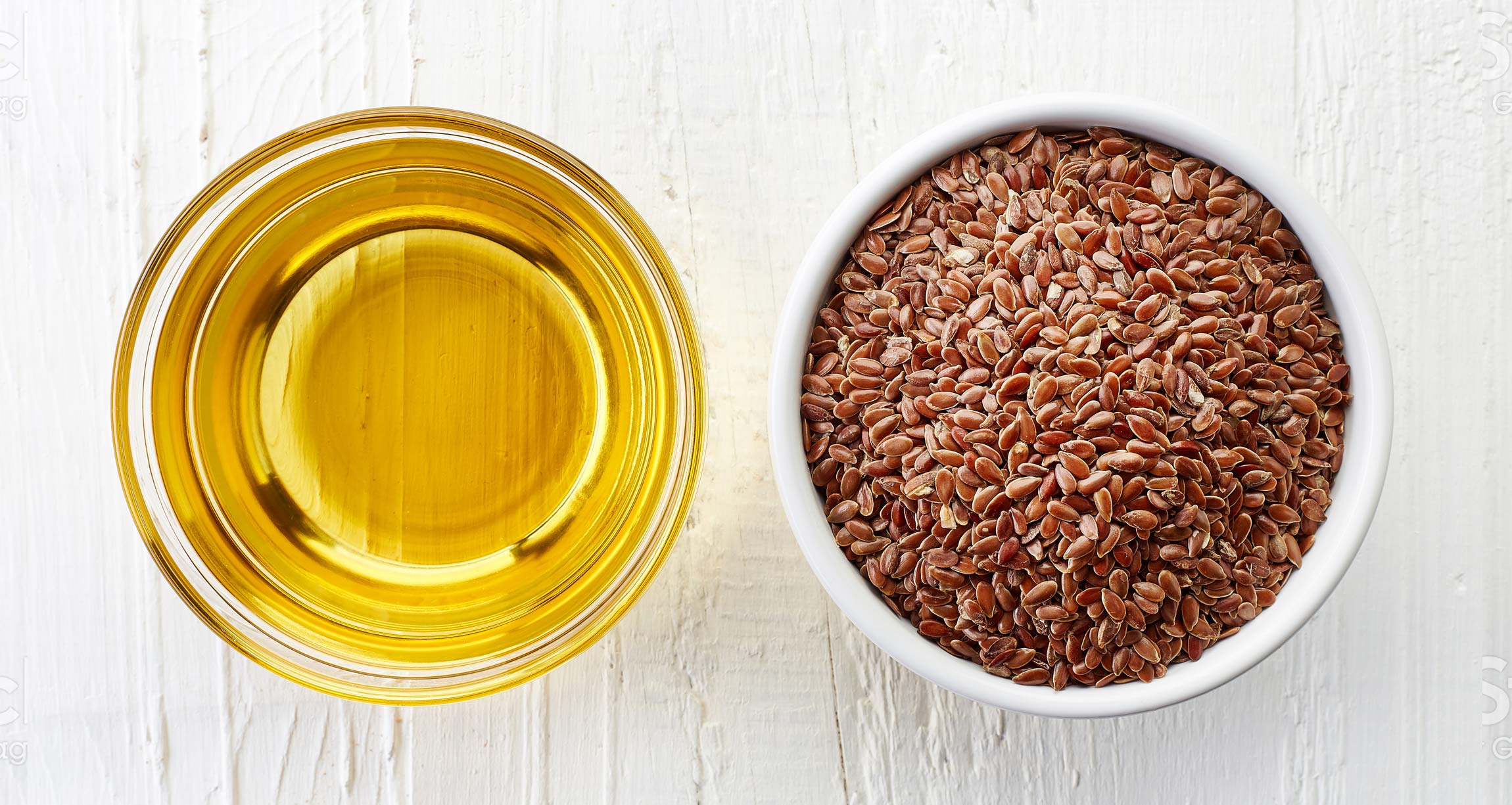 bowls of flaxseeds and oil
