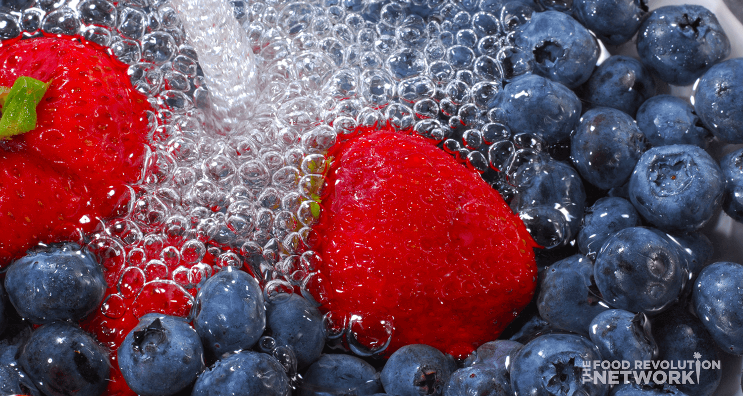 Washing fruit - blueberries and strawberries