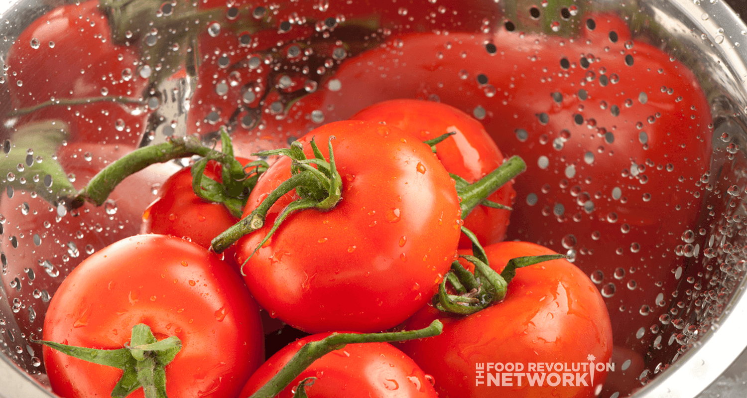 Washing produce - tomatoes - in a colander