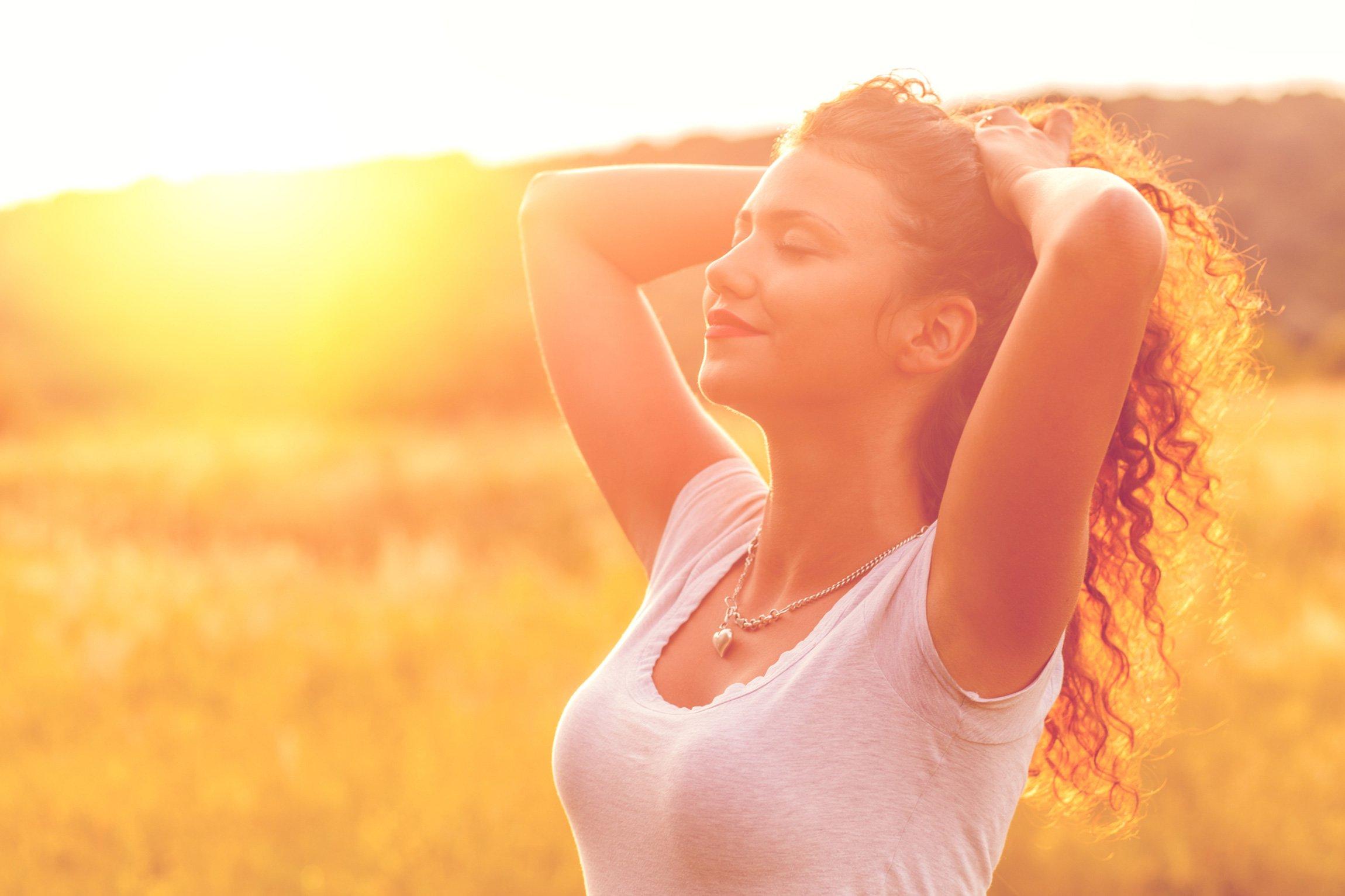 A woman enjoying the sun on her face
