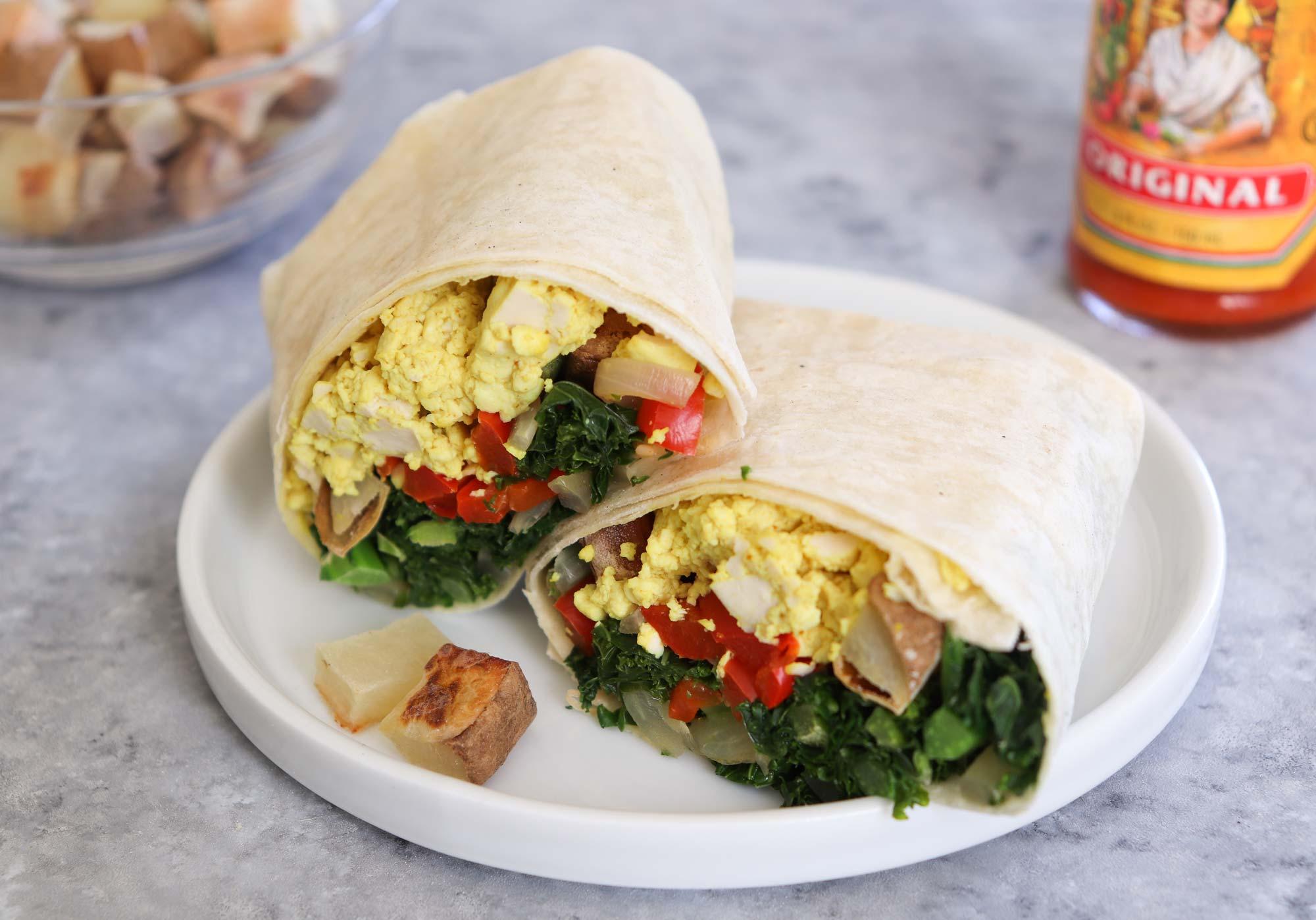 breakfast burrito halved on plate