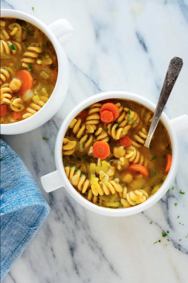 chickpea noodle soup in bowls