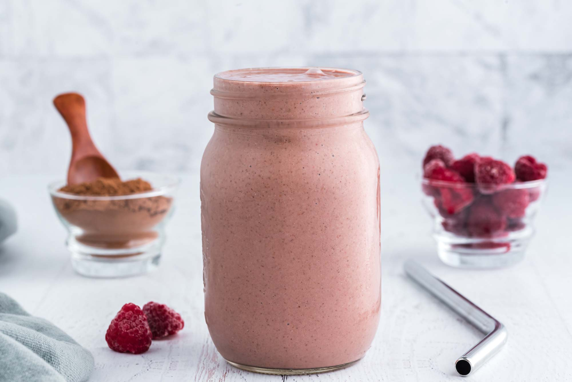 chocolate raspberry smoothie in mason jar