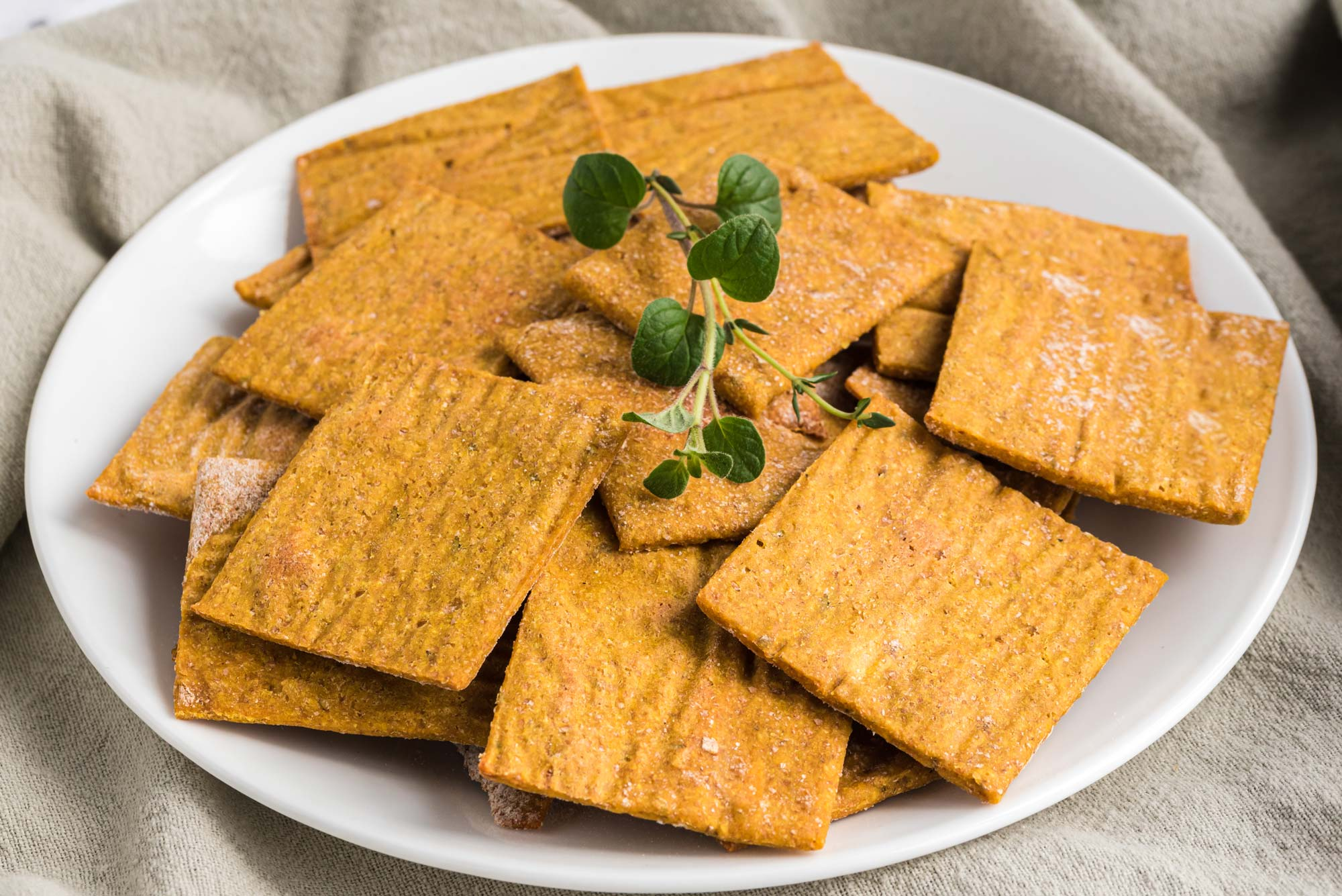 easy cheesy herbed crackers on plate