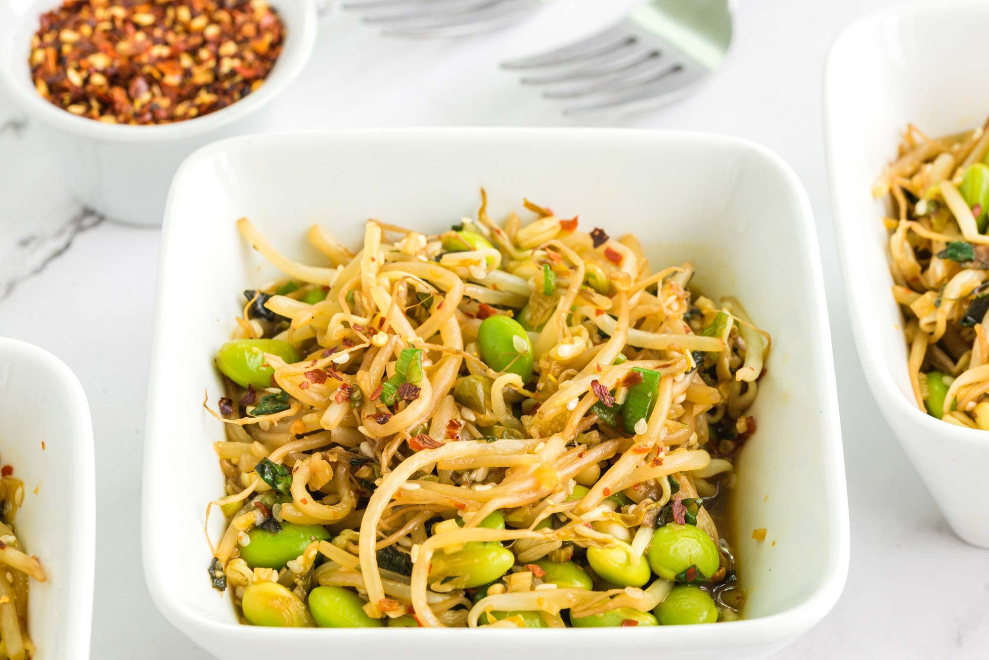 garlicky mung bean sprouts in bowls