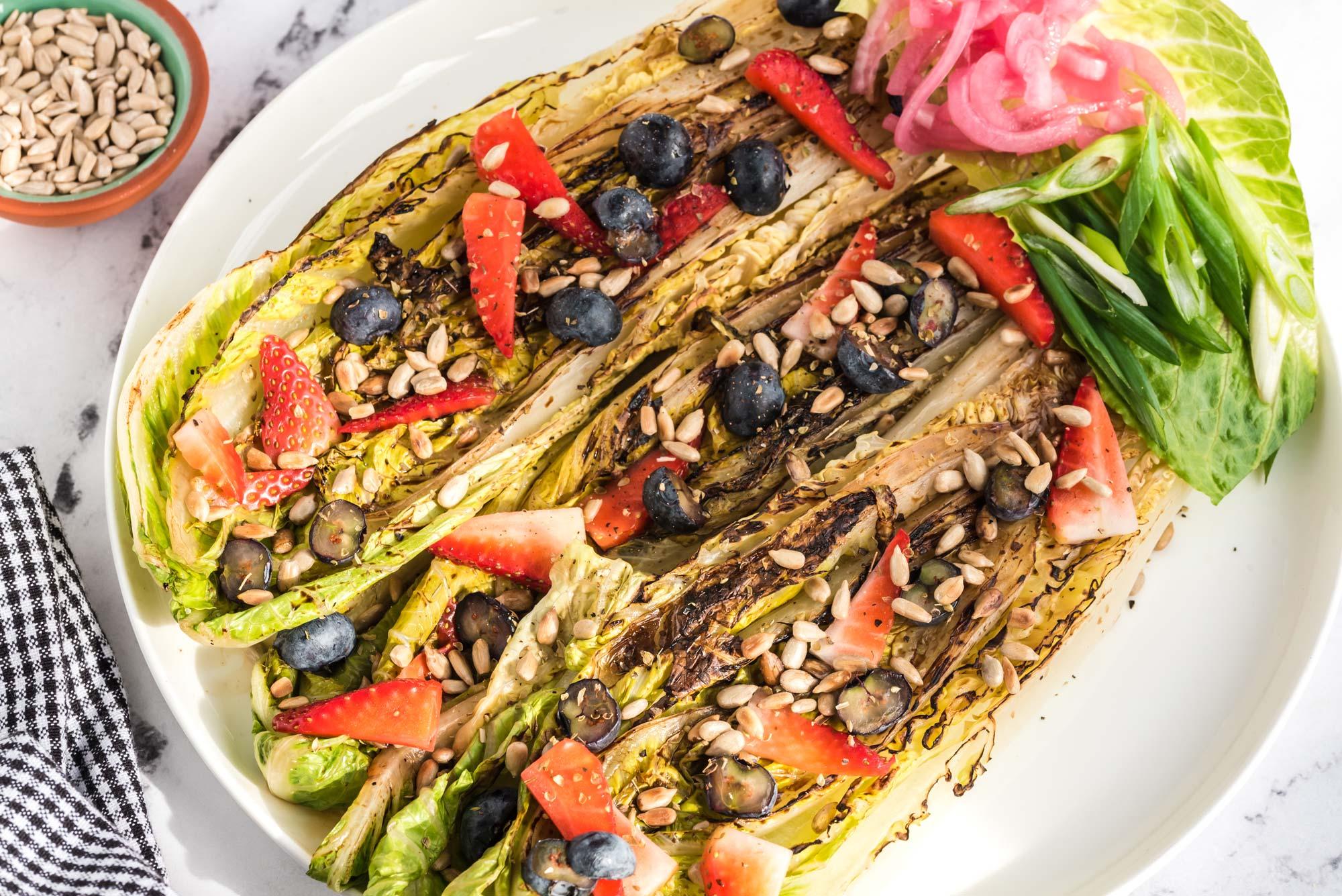 grilled romaine sunflower seed salad on plate
