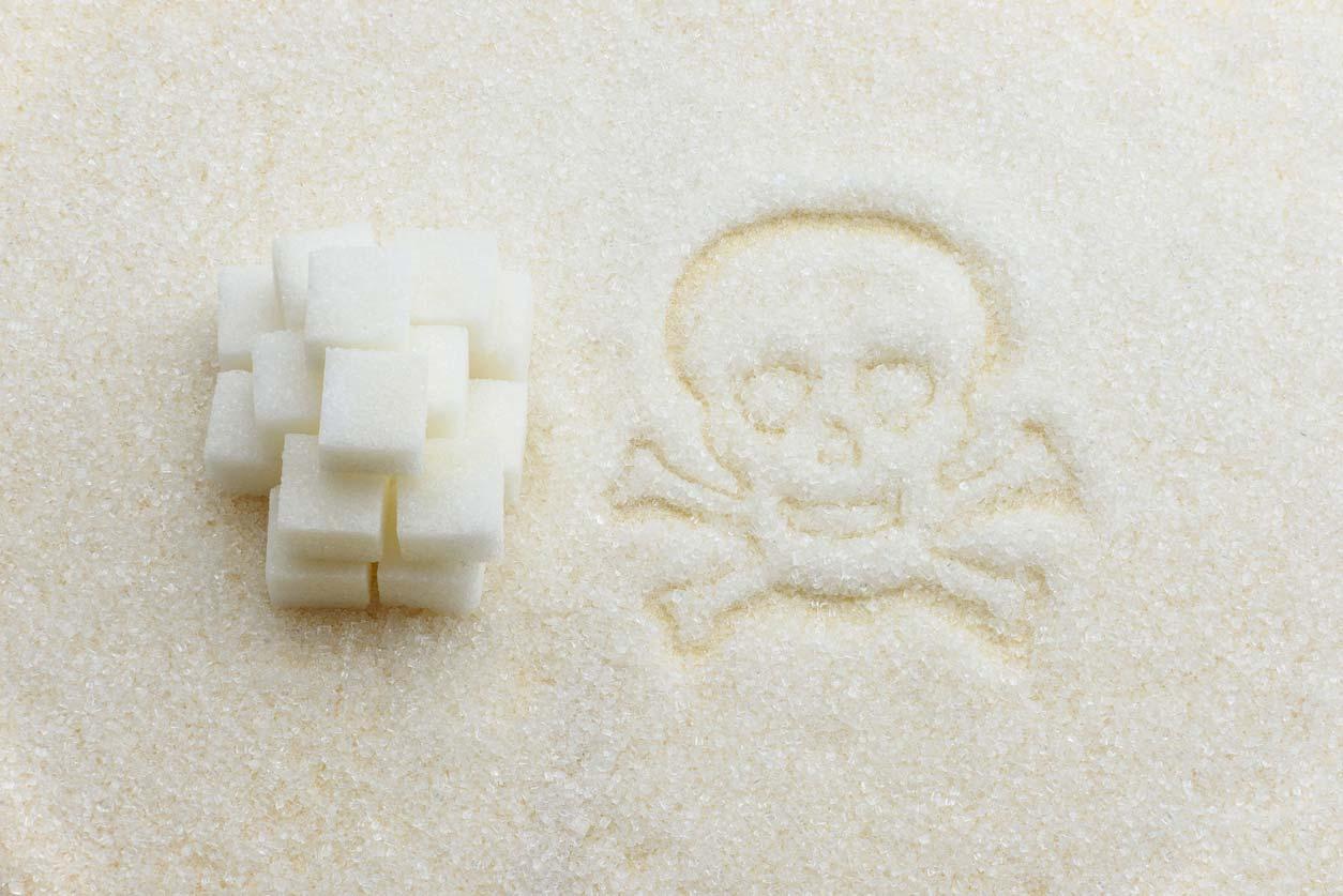 sugar cubes next to toxic symbol drawn in sugar