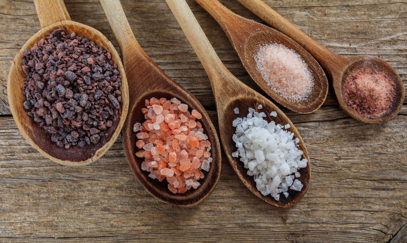 variety salts in wooden spoons