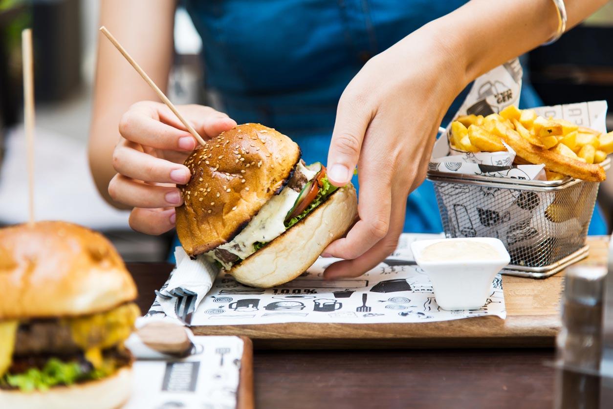 girl handling burger