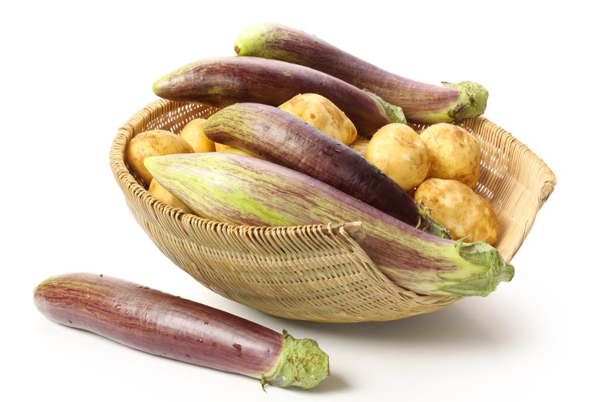 eggplant and potatoes in basket