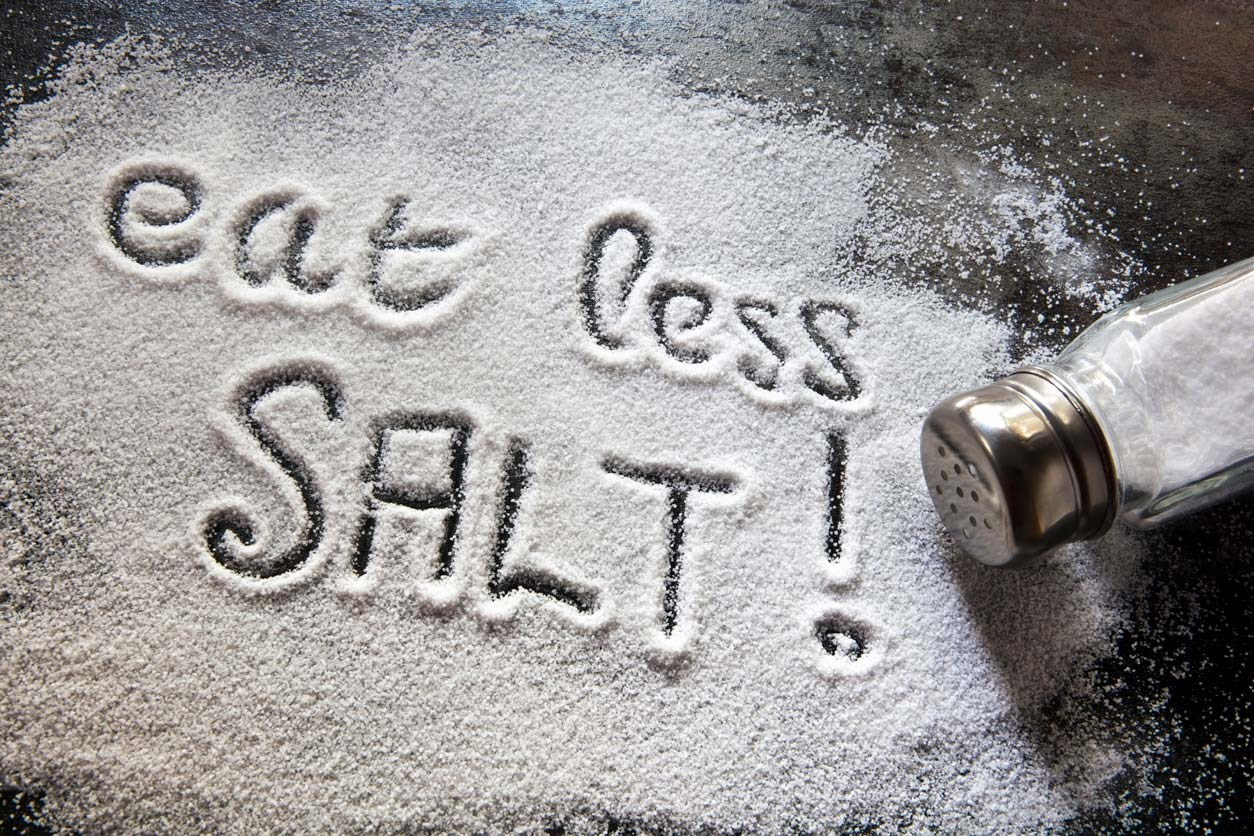 Eat less salt written in salt on table