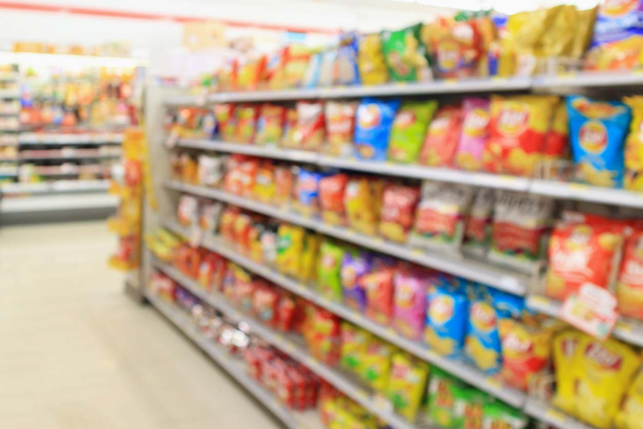 blurry shot of chip aisle at grocery store