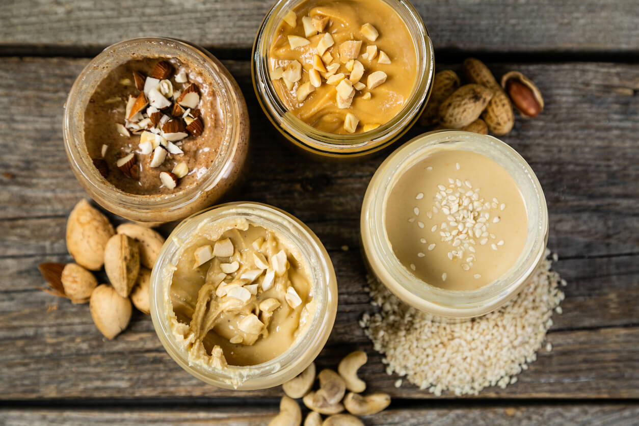 selection of nut butter including peanut cashew almond and sesame seeds