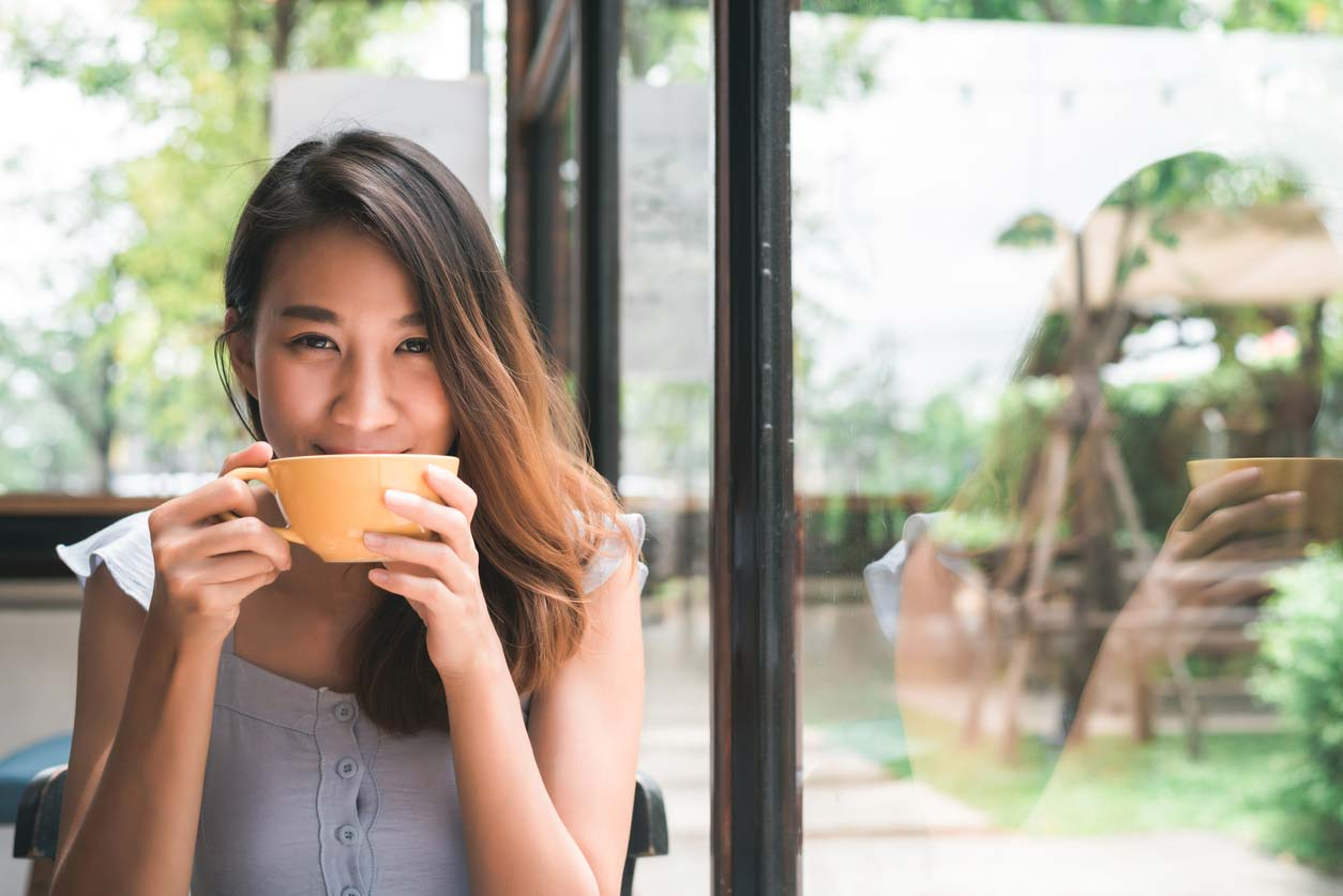 woman enjoying cup of coffee or tea