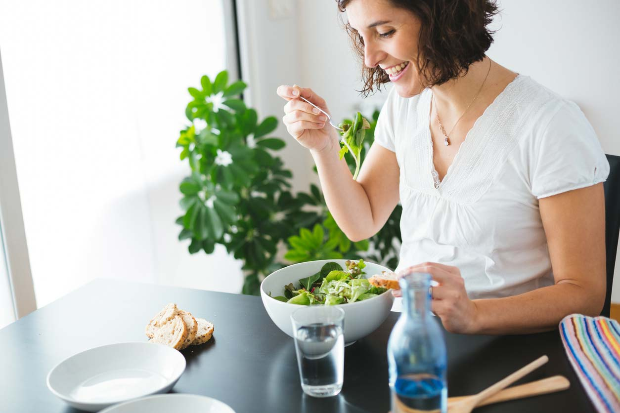 happy woman enjoying salad