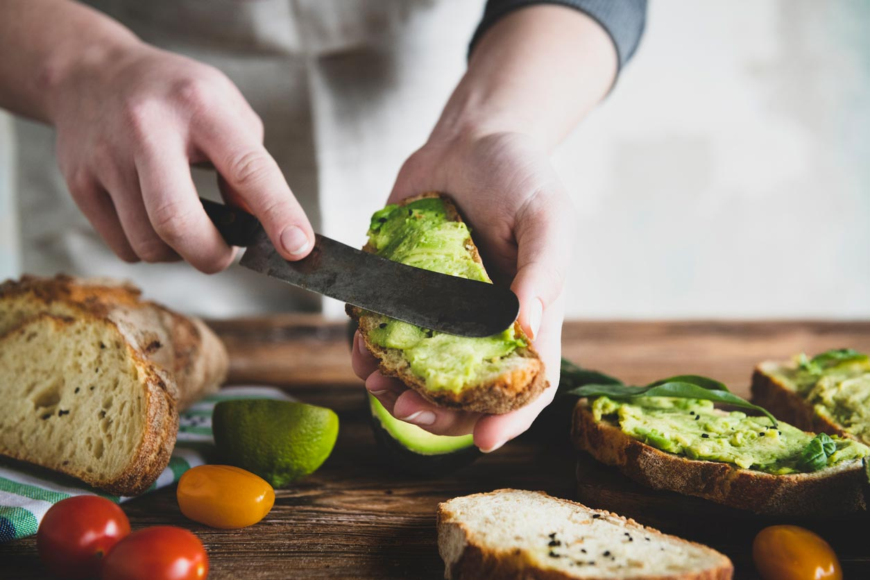 preparing an avocado sandwich