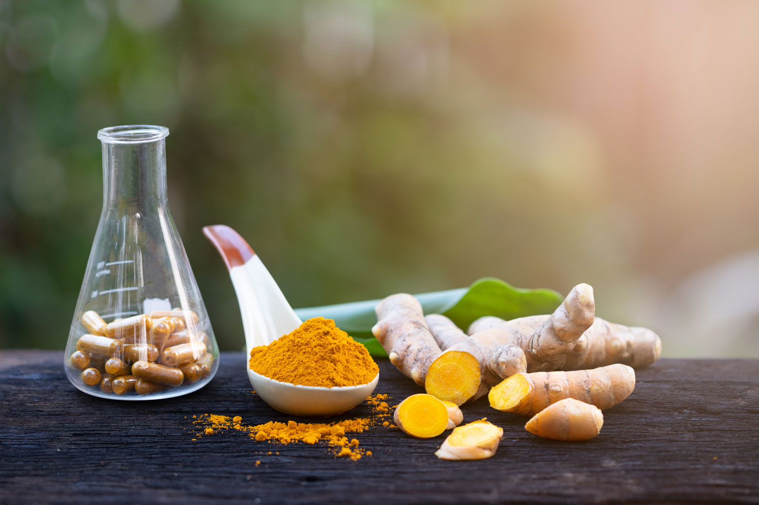 turmeric root and powder in spoon