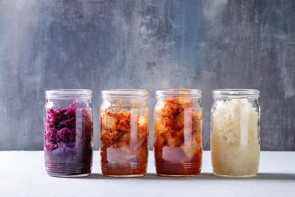 variety of kimchi in jars