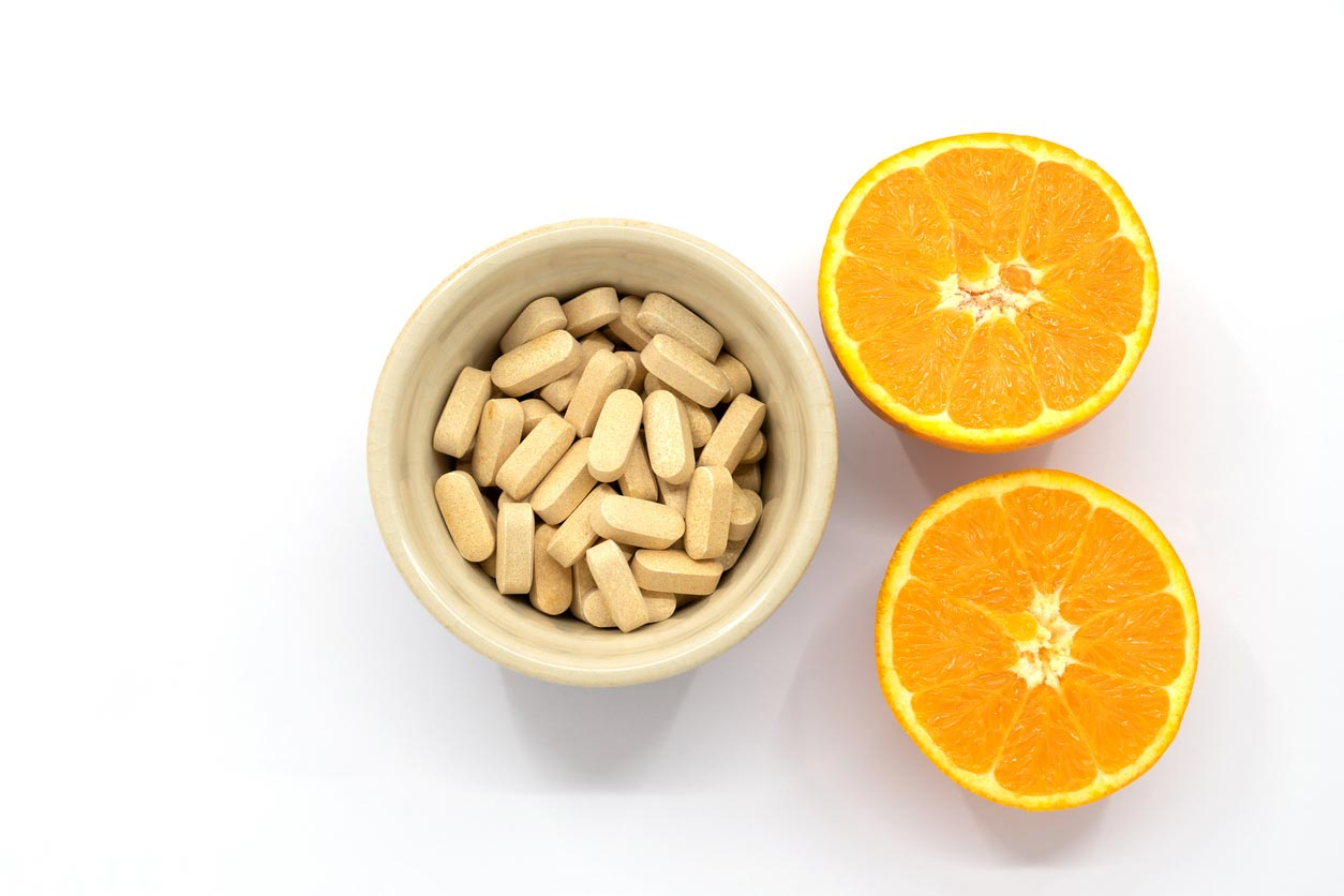 vitamin c supplement with orange halves