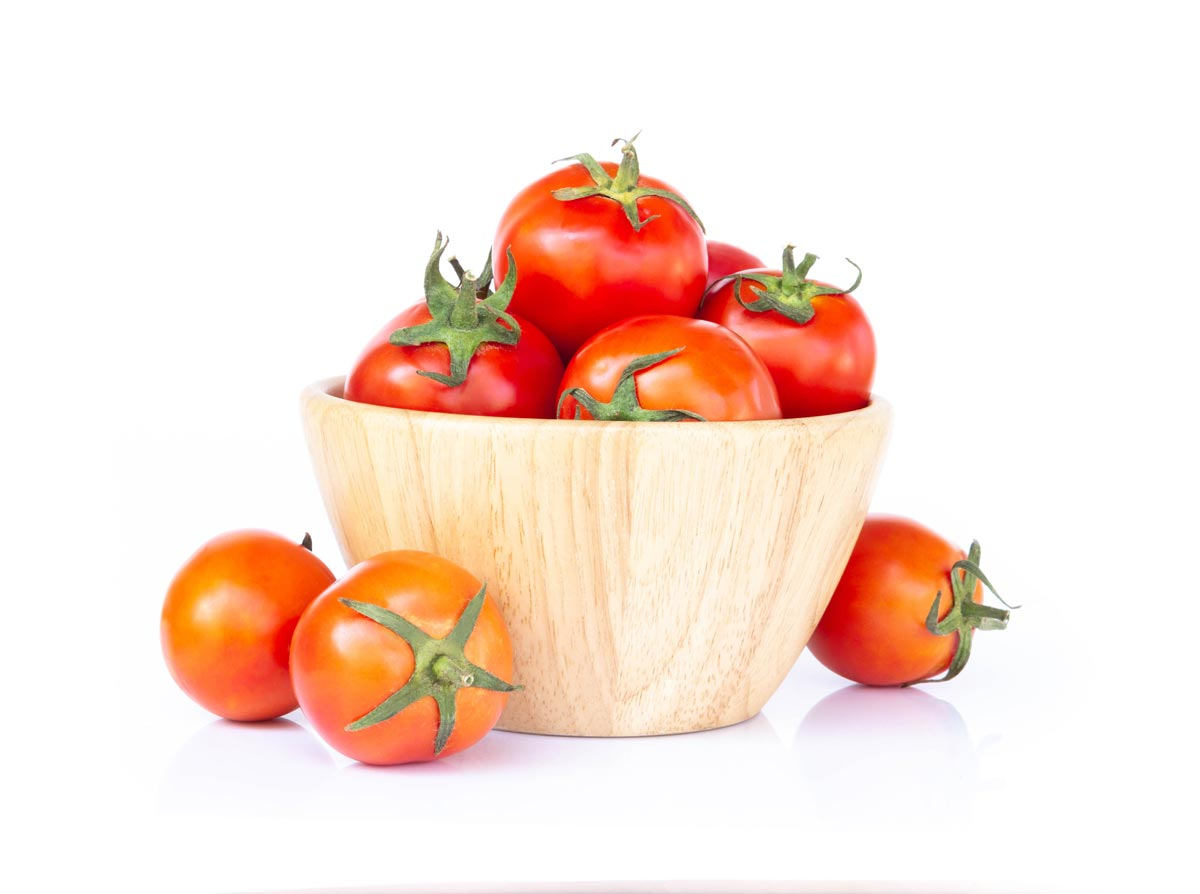 red cherry tomatoes in red bowl