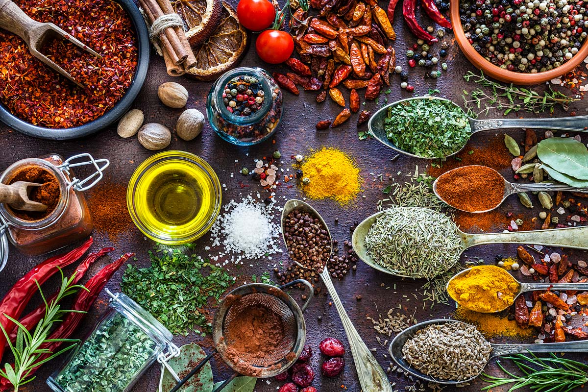 spices and herbs shot from above on rustic table