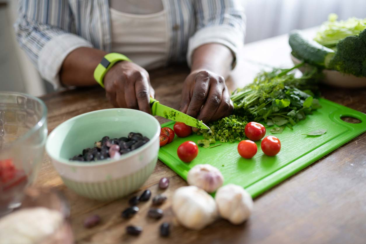 woman of color prepping veggies