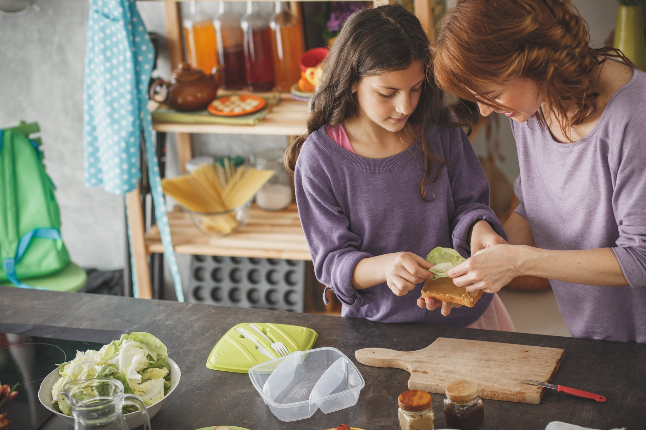 Mother and daughter preparing lunch in the kitchen