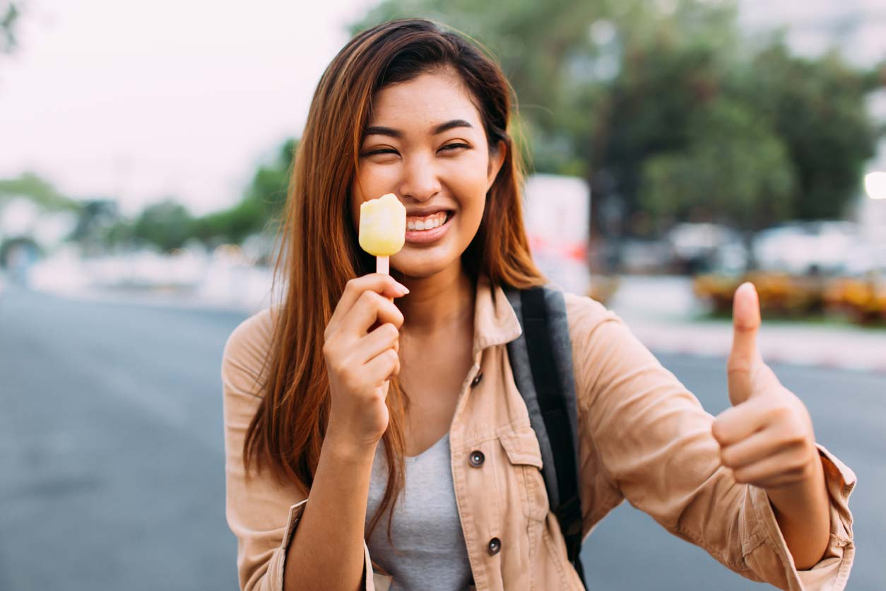woman enjoying eating a healthy popsicle