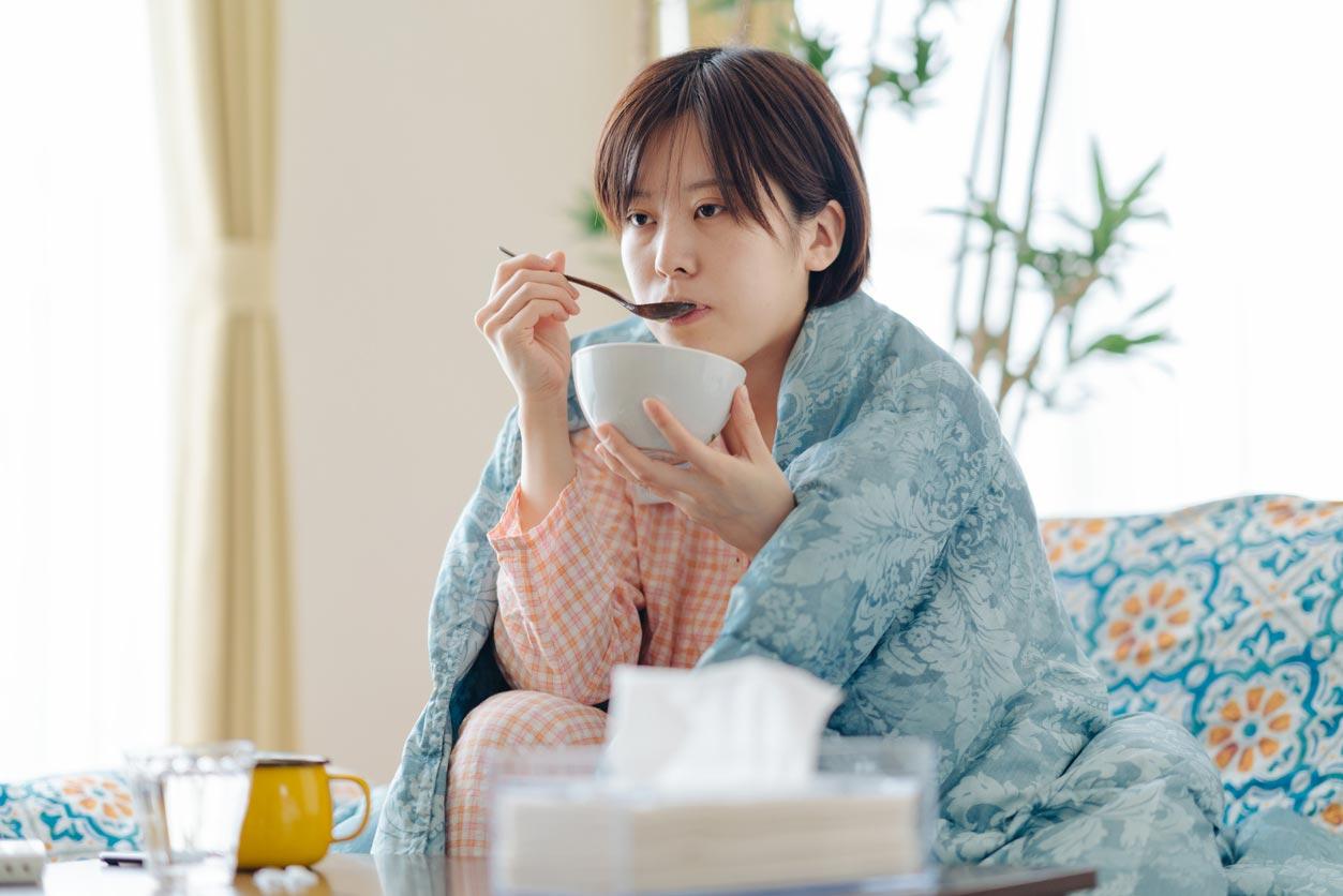 sick woman eating soup