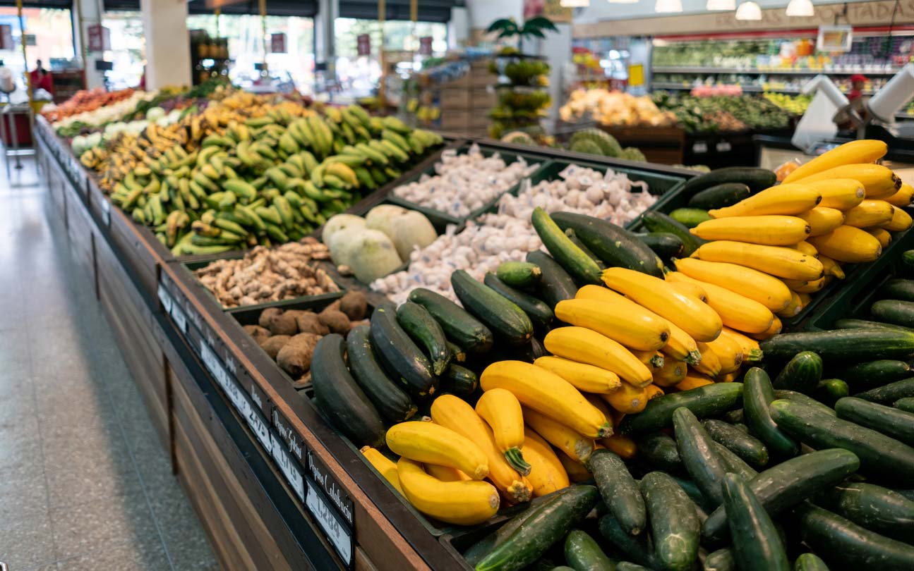 Summer squash in the produce section of grocery store