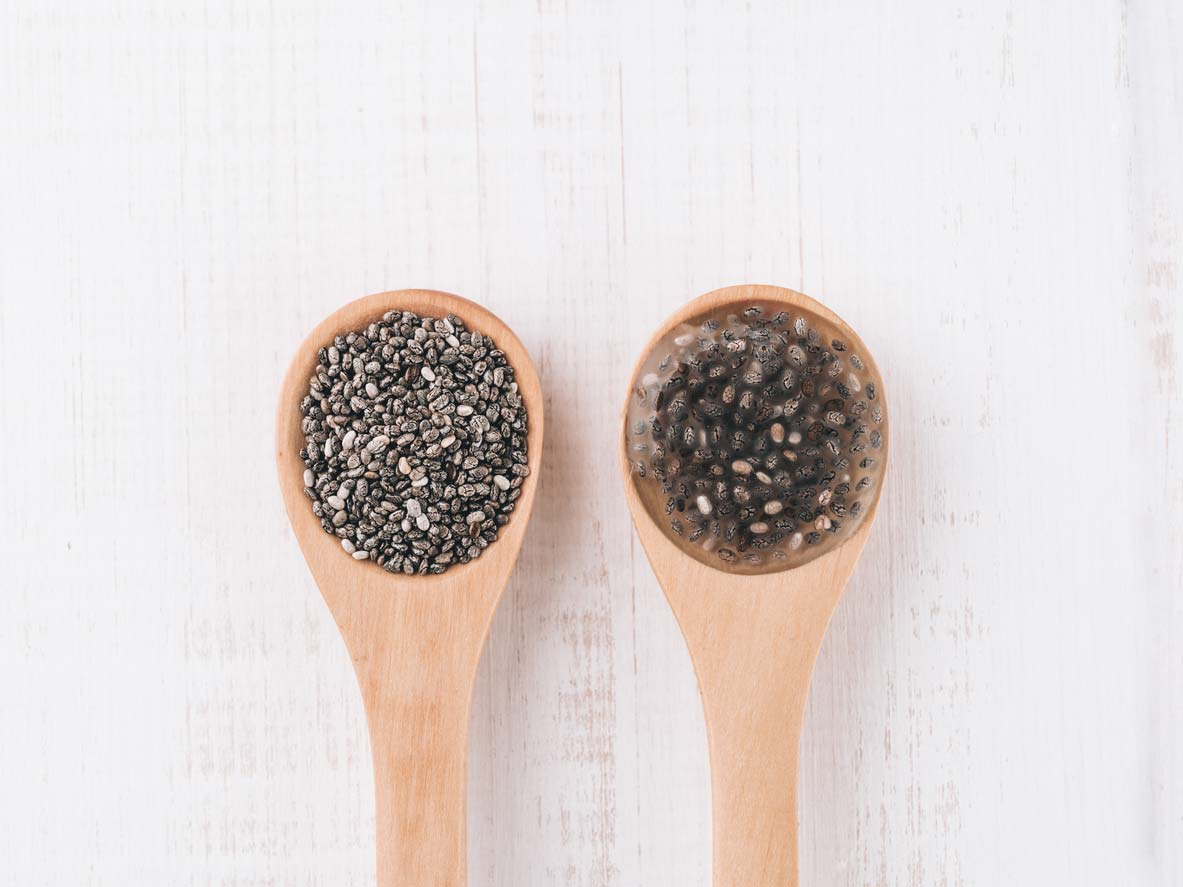 Raw chia seeds in wooden spoon; Chia egg in wooden spoon