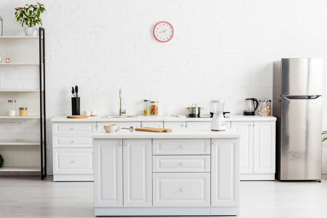 modern white kitchen with table and kitchenware