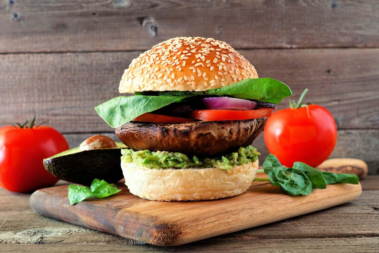Portobello mushroom burger on cutting board