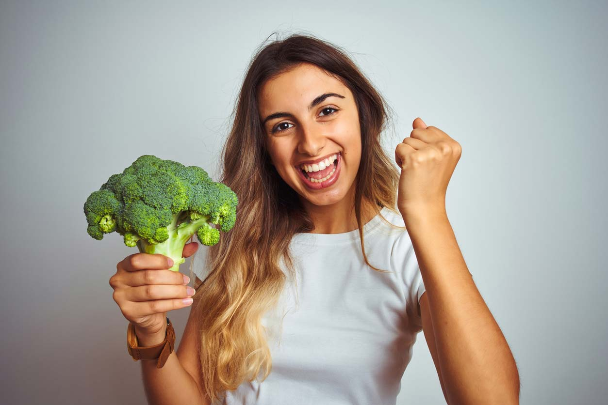woman excited about broccoli