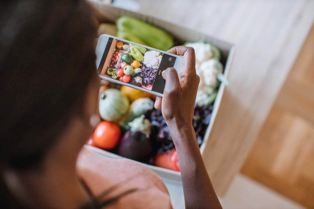 Photographing produce in a CSA box